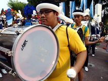 Members of a marching band play their instruments at a parade during the Sumaka Festival in Antipolo City. ANTIPOLO CITY, PHILIPPINES - MAY 1, 2017: Members of royalty free stock photos
