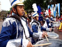 Members of a marching band play their instruments at a parade during the Sumaka Festival in Antipolo City. ANTIPOLO CITY, PHILIPPINES - MAY 1, 2017: Members of stock photos