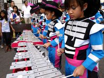 Members of a marching band play their instruments at a parade during the Sumaka Festival in Antipolo City. ANTIPOLO CITY, PHILIPPINES - MAY 1, 2017: Members of royalty free stock image