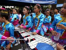 Members of a marching band play their instruments at a parade during the Sumaka Festival in Antipolo City. ANTIPOLO CITY, PHILIPPINES - MAY 1, 2017: Members of royalty free stock images