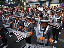 Members of a marching band play their instruments at a parade during the Sumaka Festival in Antipolo City. ANTIPOLO CITY, PHILIPPINES - MAY 1, 2017: Members of stock image