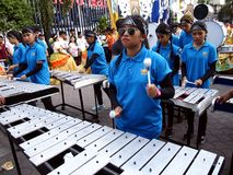 Members of a marching band play their instruments at a parade during the Sumaka Festival in Antipolo City. ANTIPOLO CITY, PHILIPPINES - MAY 1, 2017: Members of stock photo