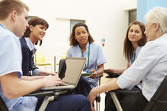 Members Of Medical Staff In Meeting Together Stock Photography