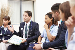 Members Of Medical Staff In Meeting Together Royalty Free Stock Photos