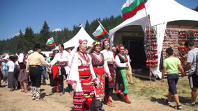Members of the National Folk Festival Rozhen in Bulgaria stock footage