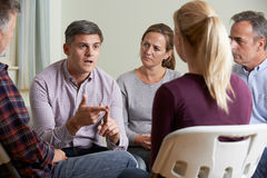 Free Members Of Support Group Sitting In Chairs Having Meeting Royalty Free Stock Photography - 65616377