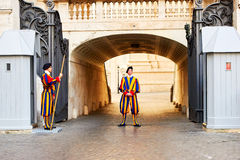 Members of the Pontifical Swiss Guard protect entrance to Vatican Royalty Free Stock Images