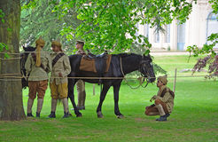Members of the Punjab Lancers in World War One uniform looking after horses. Stock Photography