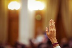 Members of Romanian Parliament vote. By raising their hands Royalty Free Stock Photography