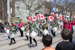 Members of Scouts Canada play drums as they march along Queen St Royalty Free Stock Image