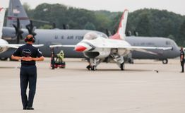 USAF Thunderbird ground team. Members of the USAF Thunderbirds ground team, go through the take off routine prior to performance at Quonset Point in North Stock Photos