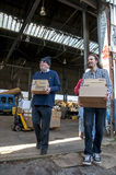 Members and volunteers from BookCycle UK carry boxes of books Royalty Free Stock Images