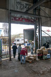 Members and volunteers from BookCycle UK load a container Stock Photo