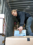 Members and volunteers from BookCycle UK load a container Royalty Free Stock Photo