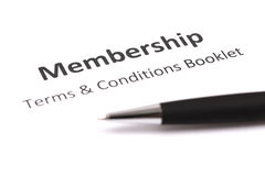 Membership with pen. Membership and terms & conditions booklet Royalty Free Stock Images