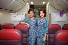 Membres malaisiens d'équipage de ligne aérienne photo stock