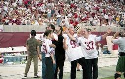 Membri dei maniaci della banda 10.000 al Sun Devil Stadium Immagine Stock