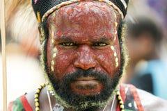 Membro duma tribo de Dani no festival anual do vale de Baliem imagem de stock