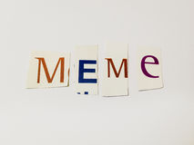 Meme - Cutout Words Collage Of Mixed Magazine Letters with White Background. Caption composed with letters torn from magazines with White Background Stock Image