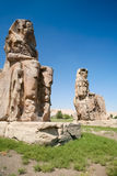 Memnon Colossi. Giant double statue of landmark Egyptian pharaoh Amenhotep III named The Colossi de Memnon, public sculpture monument in Luxor, Egypt, Africa Stock Image