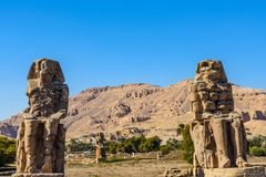Memnon colossi statues of the Pharaoh Amenhotep III in Luxor, Egypt royalty free stock photos