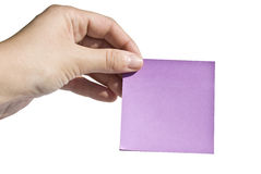 Memo. Close up on a hand holding a memo Royalty Free Stock Images