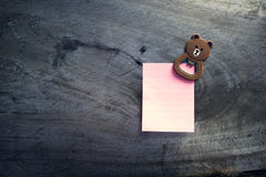 Memo background. Empty paper sheet on Wood wall. Note paper with magnetic bear Royalty Free Stock Images