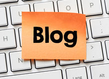 Memo with blog word. On white keyboard Stock Photography