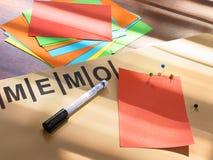 Memo board. Sticking memo on a notice board Stock Image