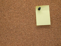 Memo board and note. Memo Tacked To Corkboard Stock Photography