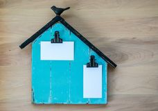 Memo board shaped like a barn with blank business cards for customized message Stock Image