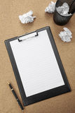 Memo clip, pen and paper on yellow desktop.  Stock Photography