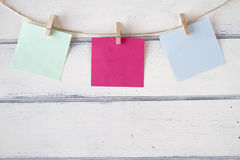 Memo. Colorful paper cards hanging on clothespins Stock Photography