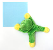 Memo frog. Magnet for refrigerator with a post-it royalty free stock photos