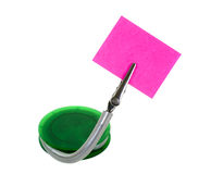 Memo Holder. Green memo holder with pink blank note; isolated on white background Stock Photo