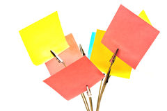 Memo holder with colorful sticky notes on white. Background Stock Image
