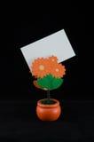 Memo holder. Orange Memo holder, flower shape Stock Photography