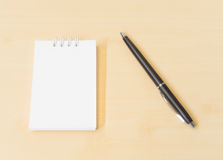 Memo Note Placed on Wooden Texture Background with Black Pen. Memo Note Placed on Wooden Texture Background with a Black Pen Royalty Free Stock Photo