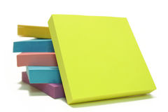 Memo Note on Stack of Postits. Stack of post its isolated over white with a blank post it up front Royalty Free Stock Photos