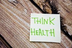 Memo note on Sticky note Think Health, think of your Helath. Memo note on Sticky note Think Health, think about Helath stock images