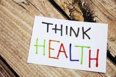 Memo note on Sticky note Think Health, think of your Helath. Memo note on Sticky note Think Health, think of Helath stock image