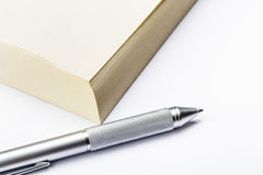 Memo pad and pen Stock Photo