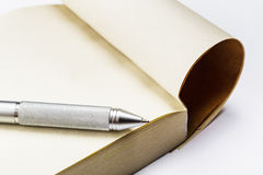 Memo pad and pen. Isolated on white Royalty Free Stock Photos