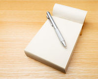 Memo pad and pen Stock Photos
