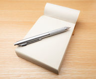 Memo pad and pen Stock Images