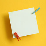 Memo pad on yellow background. Top view Stock Photo