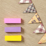 Memo paper and party paper flags garland  on beige fabric background Stock Photography