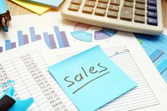Stick with word sales and financial documents. Stock Photo