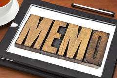 Memo word on tablet. Memo word in letterpress wood type on a digital tablet with tea Royalty Free Stock Photo