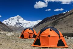Memorable camping with North face of Everest mountain view. Memorable experience with one night camping in tent with view of the north face of Everest mountain stock photo
